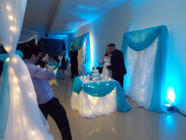 Blue Uplighting with Bride & Groom cutting the Cake, Professional Wedding DJ in New Minas, Nova Scotia