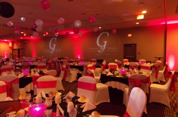 Red LED Uplighting with Two Personalized Monograms, Professional Wedding DJ in Halifax, Nova Scotia